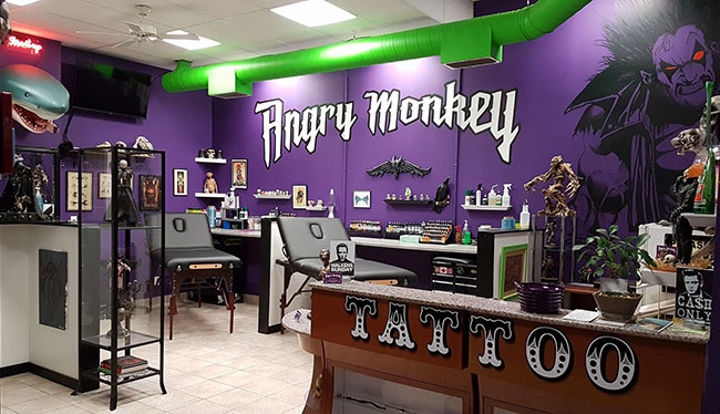 Angry monkey tattoo lethbridge tattoo shop custom for Tattoo shop design